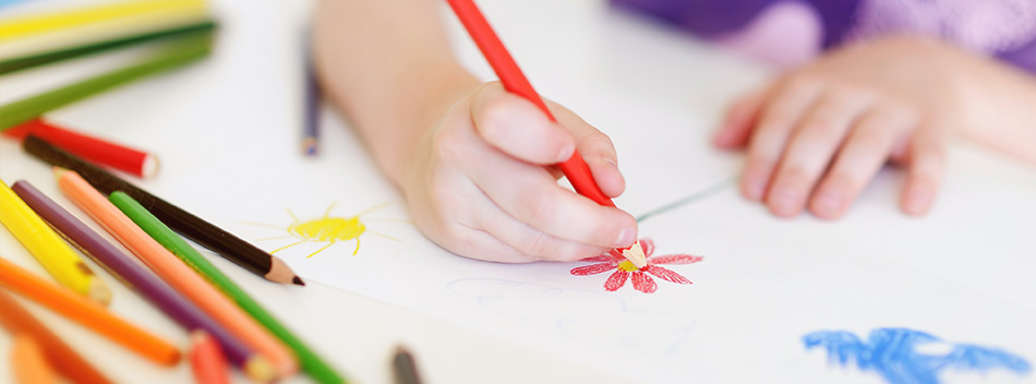 a child drawing flowers with colored pencils