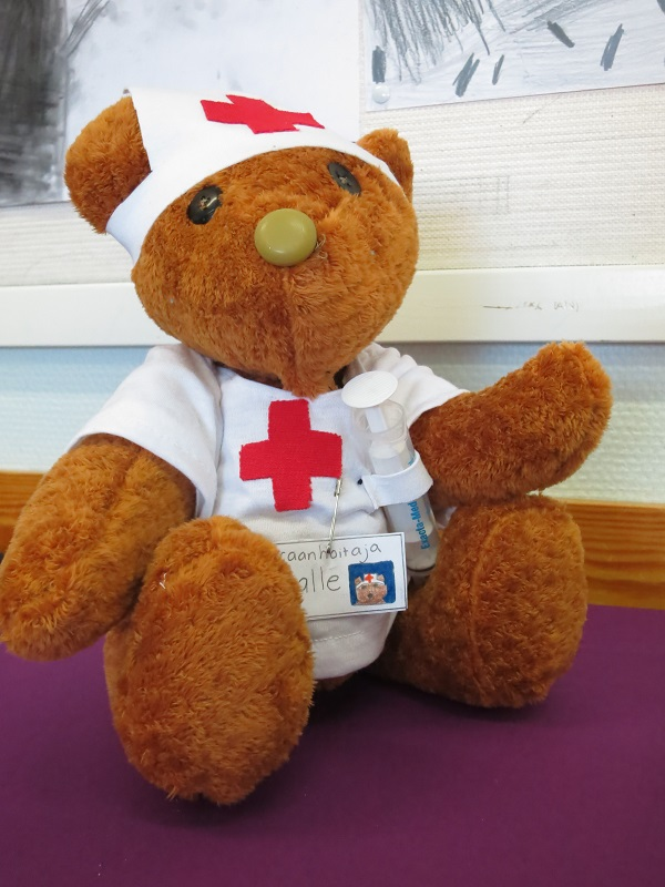 a stuffed bear with a doctors outfit